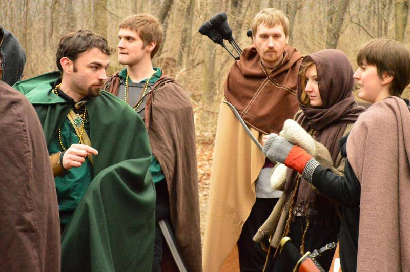 Stanrick (Green cloak on the left), Thorvald (Brown hood, tan cloak, Arrows in the center), Echo (brown head wrap, to the right) and Reyna (pinkish cloak, far right)